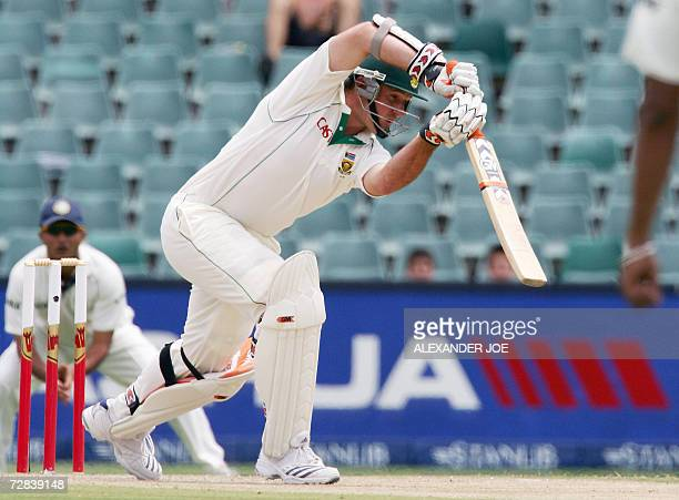 South Africa's opening batsman Graeme Smith plays a shot of the bowled of Zaheer Khan during South Africa's second innings 17 December 2006 on the...