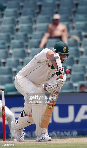South Africa's opening batsman Graeme Smith plays a shot of the bowled of Zaheer Khan of India 17 December 2006 on the third day of the first Test...