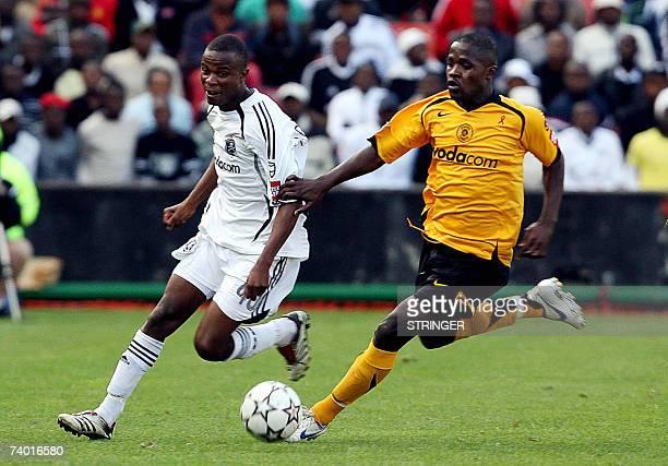 TO GO WITH AFP STORY Chiefs Rudzanik Ramudzuli breaks through 28 April 2007 Pirates Tinashe Nengomashe during the football match between Orlando...