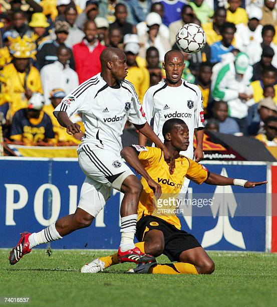 TO GO WITH AFP STORY Pirates winger Arthur Zwane is brought down 28 April 2007 by Pirates players Innocent Mdledle during the football match between...
