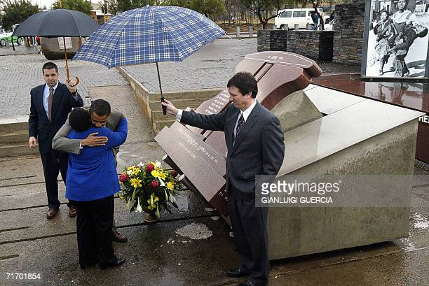 US senator for Illinois Barak Obama hugs Pieterson's sister Antoinette Sitole after laying flowers at the Hector Pieterson memorial in Soweto...