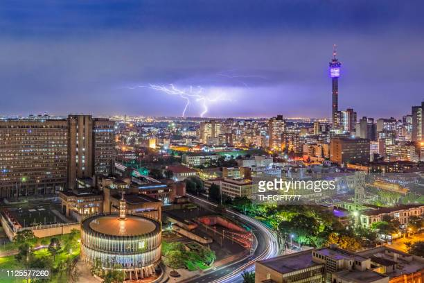 johannesburg storm and lightning with hillbrow tower and council chamber - gauteng province stock pictures, royalty-free photos & images