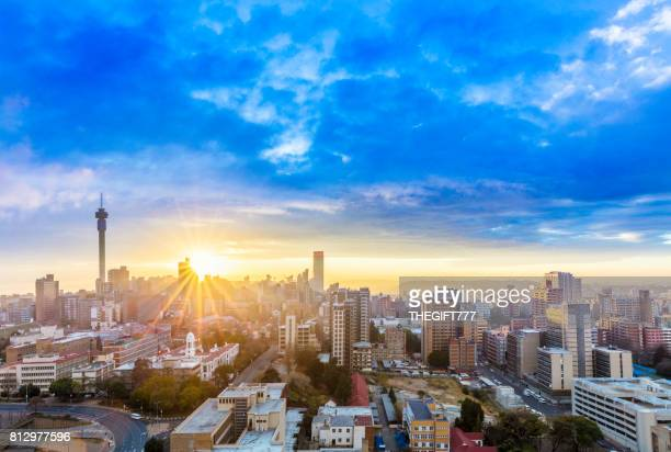 johannesburg sunrise sunflare cityscape - south africa stock pictures, royalty-free photos & images