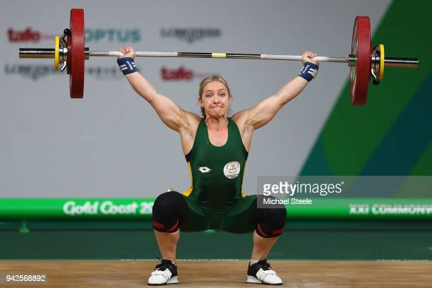 Johanni Taljaard of South Africa makes a successful lift in the snatch discipline during the Women's Weightlifting 58kg on day two of the Gold Coast...