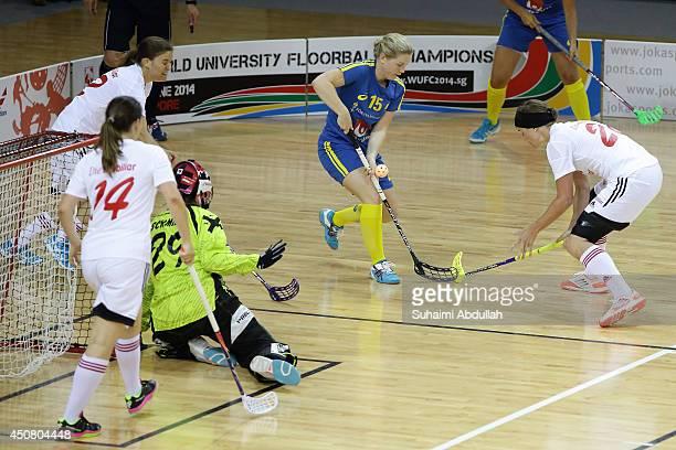 Johannson Julia of Sweden and Irene Rass of Switzerland challenge for the ball during the World University Championship Floorball match between...