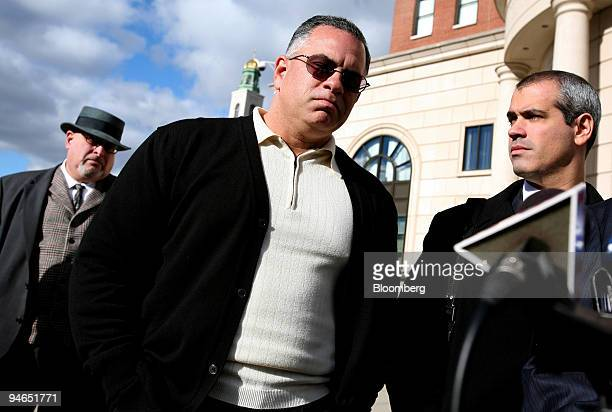 John A Junior Gotti center son of the late Gambino family crime boss listens to attorneys address members of the media after a hearing on his tax...