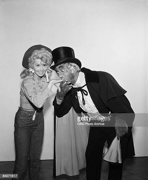 John Abbott as Sir Trevor Gielgud BurtonGuinness kisses the hand of Donna Douglas as Elly May from The Beverly Hillbillies 1964