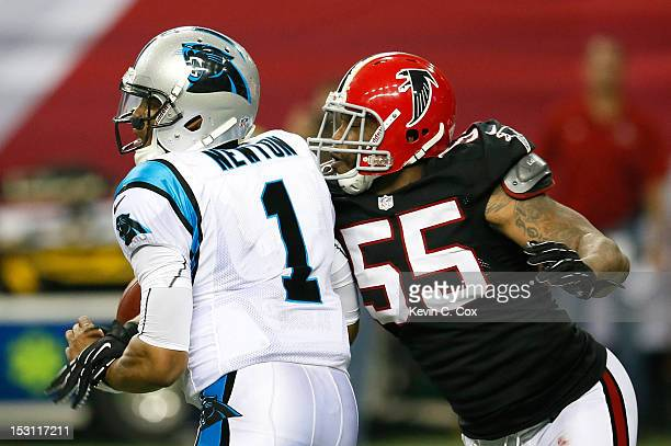 John Abraham of the Atlanta Falcons sacks Cam Newton of the Carolina Panthers on the final play of the game at Georgia Dome on September 30 2012 in...