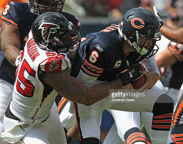 John Abraham of the Atlanta Falcons sacks Jay Cutler of the Chicago Bears at Soldier Field on September 11, 2011 in Chicago, Illinois. The Bears...