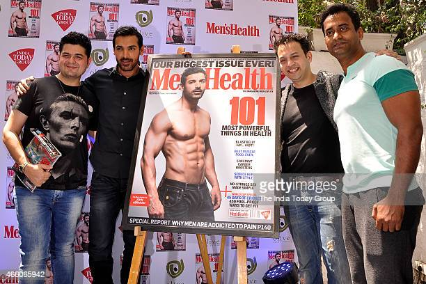 John Abraham with editor of Mens Health magazine Jamal Shaikh and Dabboo Ratnani at the cover launch of Mens Health magazine featuring John Abraham...