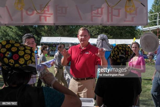John Adams who is in a heated attorney general's race in Virginia this fall makes an appearance at the 15th KORUS Festival at Sully Historic Site on...