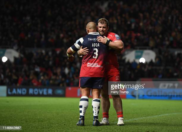 John Afoa of Bristol Bears and WillGriff John of Sale Sharks hug at the final whistle during the Gallagher Premiership Rugby match between Bristol...
