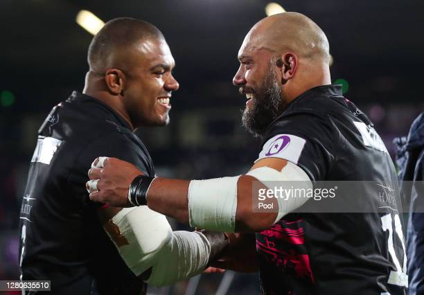 John Afoa of Bristol Bears celebrates with Kyle Sinckler of Bristol Bears following victory during the European Rugby Challenge Cup Final between...