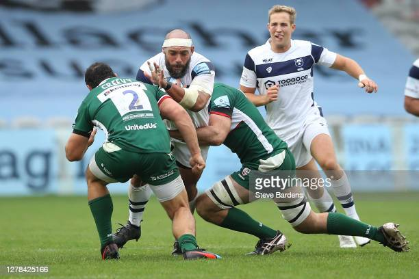 John Afoa of Bristol Bears is tackled by Matt Rogerson and Agustin Creevy of London Irish during the Gallagher Premiership Rugby match between London...