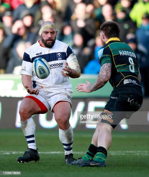 John Afoa of Bristol Bears passes the ball as Teimana Harrison looks on during the Gallagher Premiership Rugby match between Northampton Saints and...