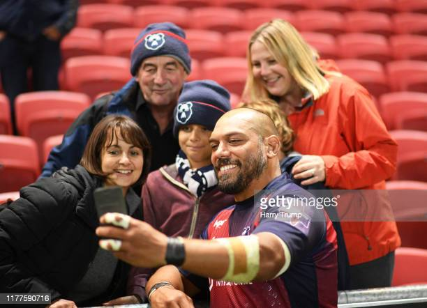 John Afoa of Bristol Bears poses for a selfie with fans during the Premiership Rugby Cup Second Round match between Bristol Bears and Gloucester...