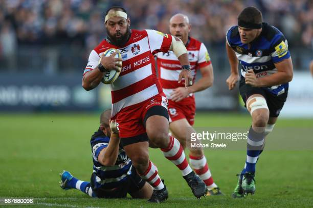 John Afoa of Gloucester is pulled back by Tom Dunn of Bath during the Aviva Premiership match between Bath Rugby and Gloucester Rugby at the...