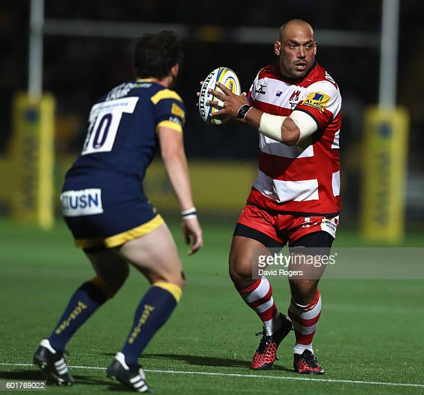 John Afoa of Gloucester runs with the ball during the Aviva Premiership match between Worcester Warriors and Gloucester at Sixways Stadium on...