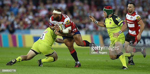 John Afoa of Gloucester takes on Greg Bateman uring the Aviva Premiership match between Gloucester and Leicester Tigers at Kingsholm Stadium on...