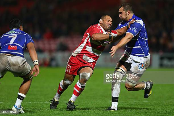John Afoa of Gloucesterholds off Russian Boukerou R of Brive during the European Rugby Challenge Cup Pool 5 match between Gloucester Rugby and Brive...