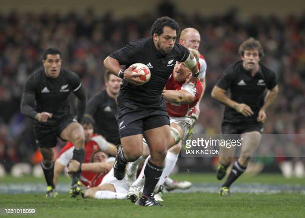 John Afoa of New Zealand runs through to score his try during the Autumn International rugby union match between Wales and New Zealand at The...