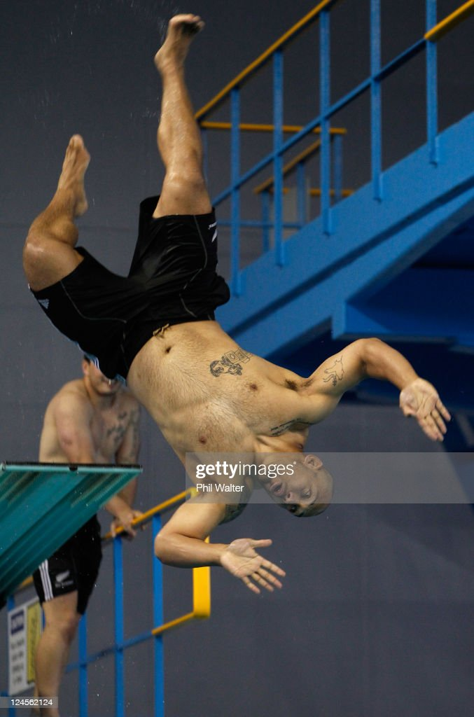 John Afoa of the All Blacks dives during a New Zealand All Blacks IRB Rugby World Cup 2011 recovery session at the Waterworld Aquatic Centre on September 11, 2011 in Hamilton, New Zealand.