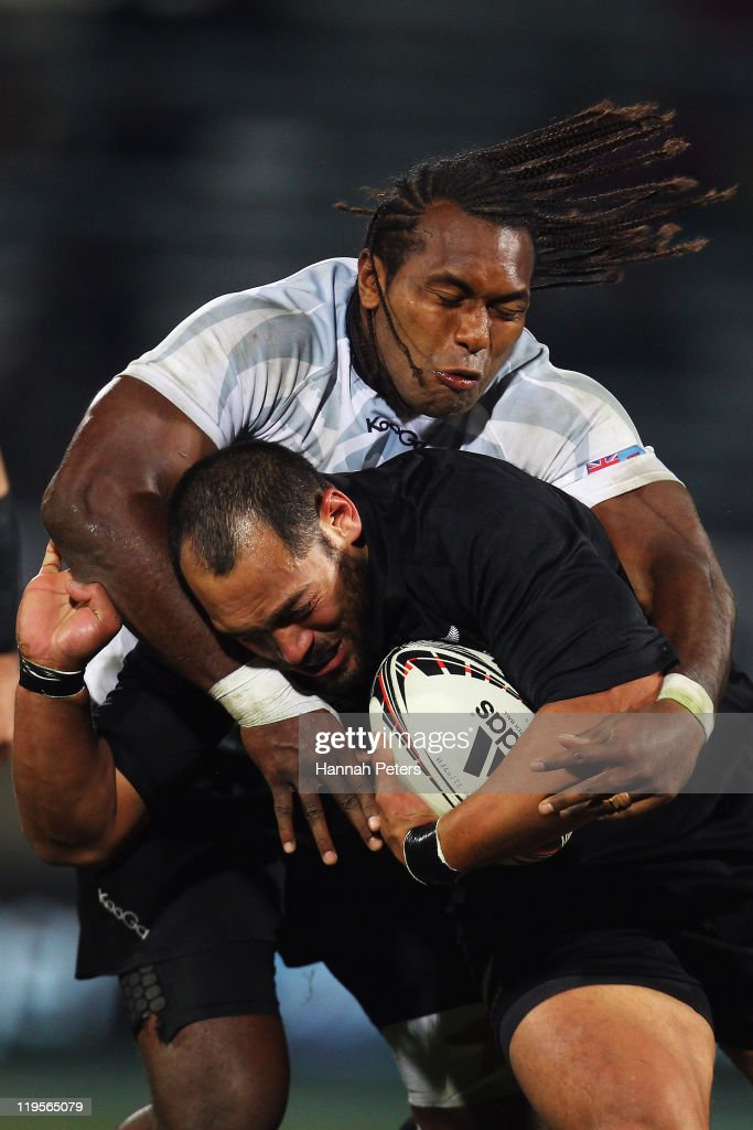 John Afoa of the All Blacks is tackled by Albert Vulivuli of Fiji during the International Test match between the New Zealand All Blacks and Fiji Bati at Carisbrook on July 22, 2011 in Dunedin, New Zealand.