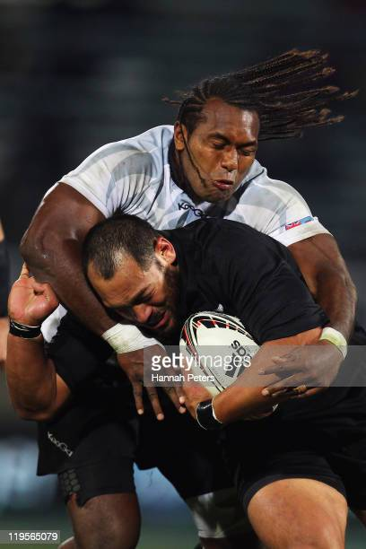 John Afoa of the All Blacks is tackled by Albert Vulivuli of Fiji during the International Test match between the New Zealand All Blacks and Fiji...