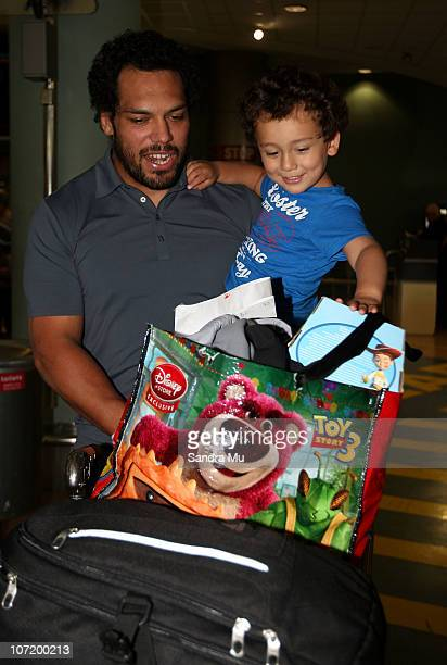 John Afoa of the All Blacks is welcomed by his son Mateo on his arrival home at Auckland International Airport following the New Zealand All Blacks...