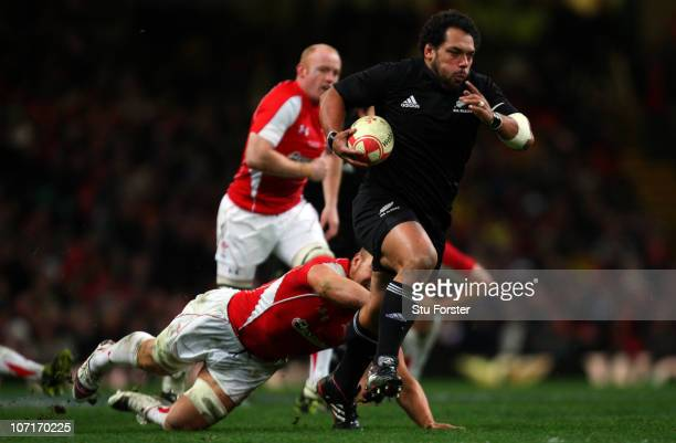 John Afoa of the All Blacks runs through the Wales defence to score the last try during the Test match between Wales and the New Zealand All Blacks...