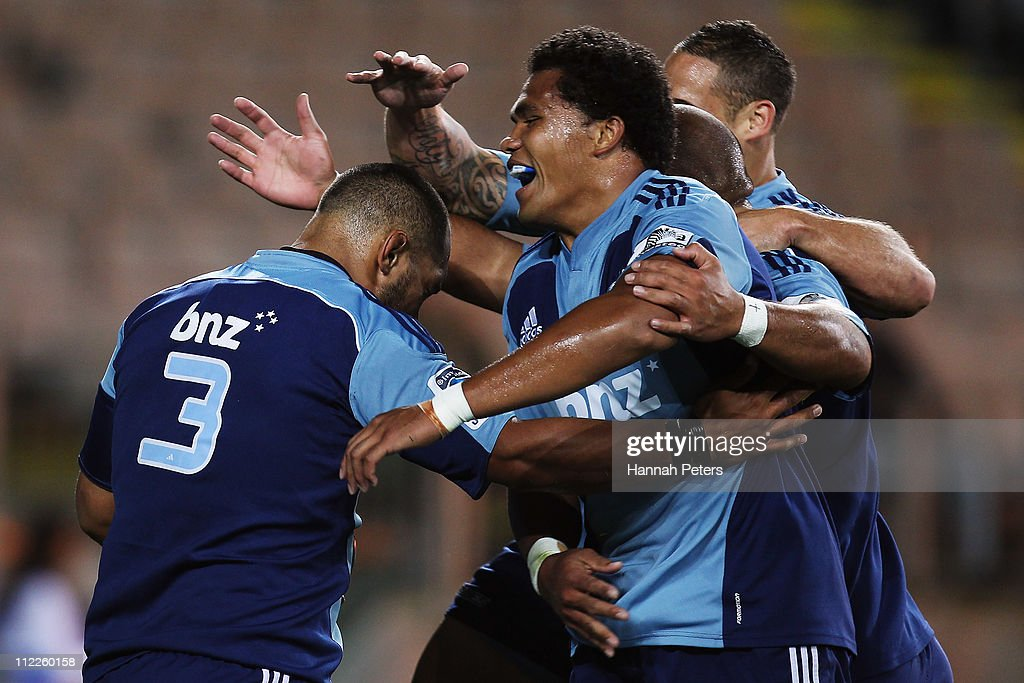 John Afoa of the Blues celebrates after scoring a try with Luke McAlister, Tevita Mailau and Peter Saili during the round nine Super Rugby match between the Blues and the Waratahs at Eden Park on April 16, 2011 in Auckland, New Zealand.