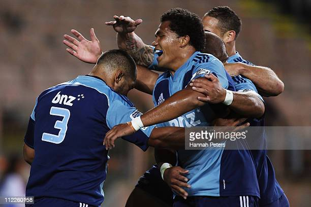 John Afoa of the Blues celebrates after scoring a try with Luke McAlister Tevita Mailau and Peter Saili during the round nine Super Rugby match...