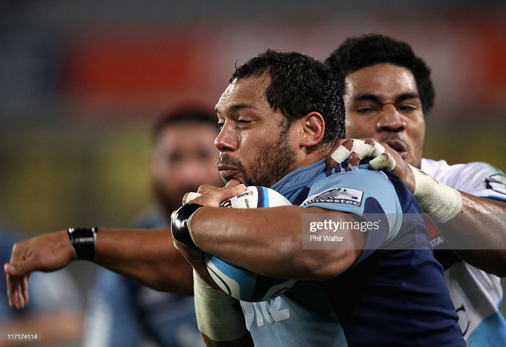 John Afoa of the Blues is tackled by Sitaleki Timani of the Waratahs during the Super Rugby qualifier match between the Blues and the Waratahs at Eden Park on June 24, 2011 in Auckland, New Zealand.