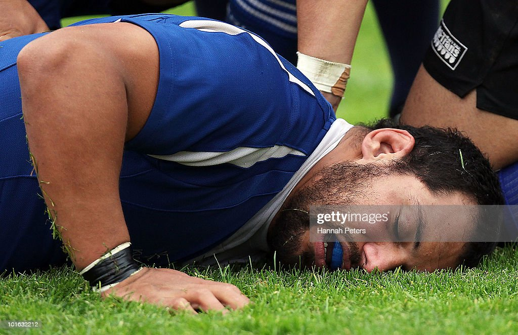 John Afoa of University lies on the ground after collapsing in a scrum during the club rugby match between Ponsonby and University at Western Springs Stadium on June 5, 2010 in Auckland, New Zealand.