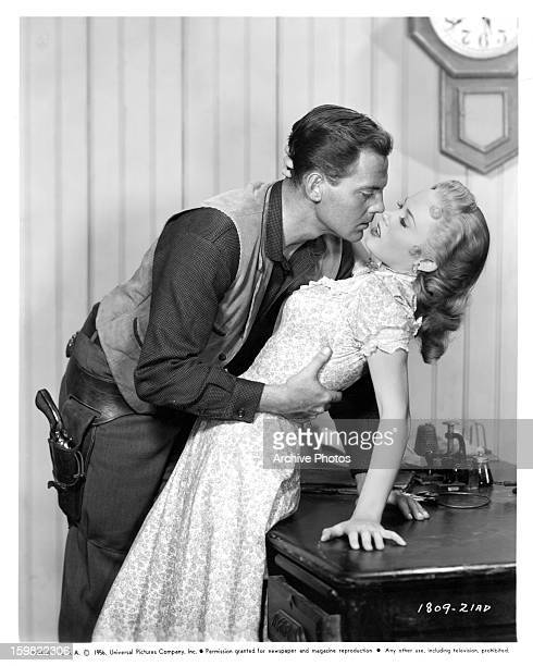 John Agar advances on Mamie Van Doren in a scene from the film 'Star In The Dust' 1956
