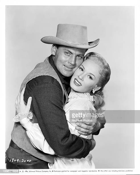 John Agar holds Mamie Van Doren in publicity portrait for the film 'Star In The Dust' 1956