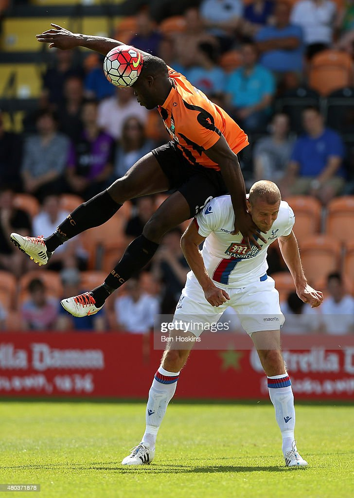 John Akinde of Barnet and Brede Hangeland of Crystal Palace battle for an aerial ball during a Pre Season Friendly between Barnet and Crystal Palace at The Hive on July 11, 2015 in Barnet, England.