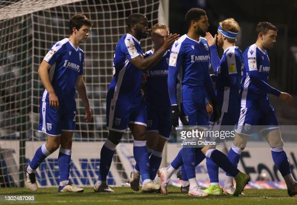 John Akinde of Gillingham FC celebrates with Kyle Dempsey and Connor Ogilvie after scoring his sides first goal during the Sky Bet League One match...