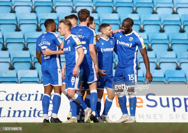 John Akinde of Gillingham FC celebrates with Stuart O'Keefe after scoring his sides second goal during the Sky Bet League One match between...