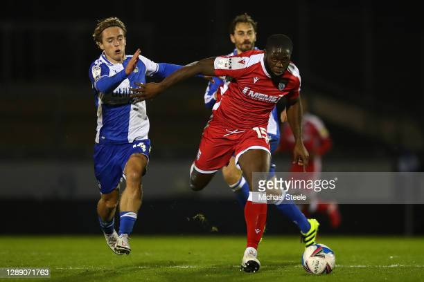John Akinde of Gillingham holds off Luke McCormick of Bristol Rovers during the Sky Bet League One match between Bristol Rovers and Gillingham at...