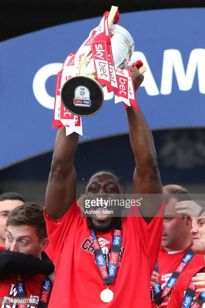 John Akinde of Lincoln City lifts the trophy during the Sky Bet League Two match between Lincoln City and Colchester United at Sincil Bank Stadium on...