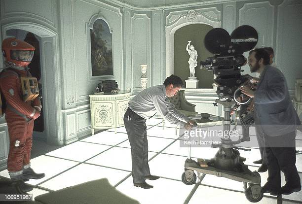 John Alcott adjusts the camera position whilst film director and screenwriter Stanley Kubrick finds his shot on the set of '2001 A Space Odyssey' at...
