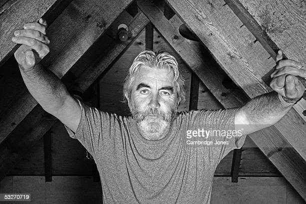 John Alderton poses during a photo call held on July 16 2004 at his home in London England