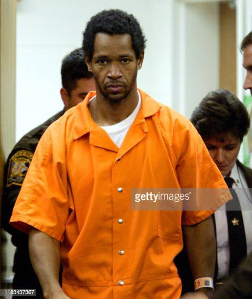 John Allen Muhammad, one of two men accused in a series of sniper attacks in the Washington, DC, area, arrives for his appearance before Judge Leroy...