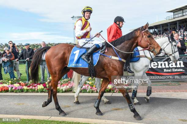 John Allen returns to the mounting yard aboard Try Four after winning the Hammonds Paint Champion Novice Hurdle at Warrnambool Racecourse on May 04...
