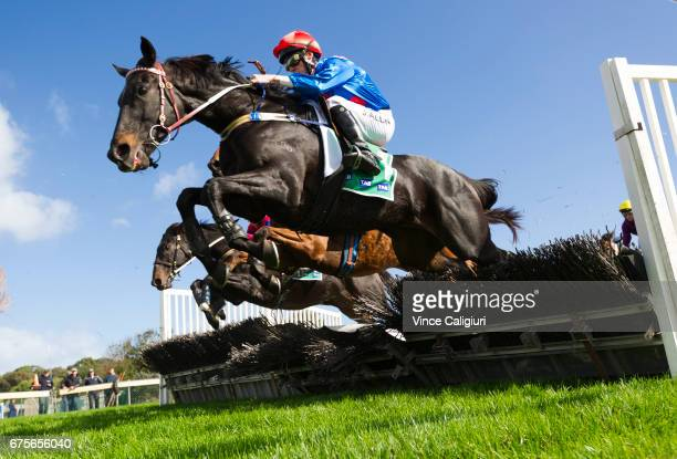 John Allen riding Ancient King jumping over hurdle before winning Race 2 Maiden Hurdle during the Warrnambool Racing Carnival on May 2 2017 in...