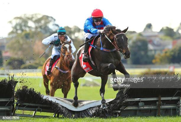 John Allen riding Ancient King wins race 5 the Grand National Hurdle during Grand National Hurdle Day at Sandown Lakeside on August 6 2017 in...
