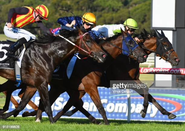 John Allen riding Peaceful State defeats Kaching and Call Me Handsome in Race 7 during Melbourne Racing at Sandown Lakeside on February 7 2018 in...