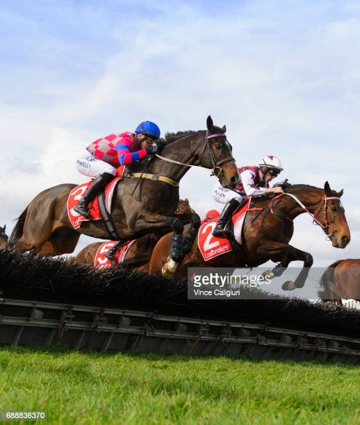 John Allen riding Renew jumping before defeating Martin Kelly riding Urban Explorer in Race 4 The Australian Hurdle during Melbourne Racing at...