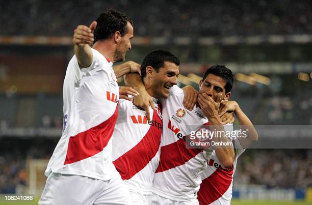 John Aloisi and Simon Colosimo of the Heart celebrate Aloisi's goal with fellow teammates during the round 24 ALeague match between the Melbourne...
